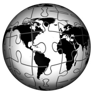 Un puzzle projeté sur un globe terrestre